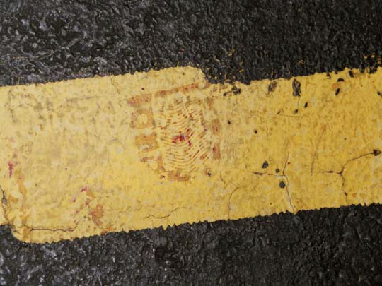 Bloody shoe print heel found at police marker 3 in jog in yellow painted lane stripe. CBS News photo