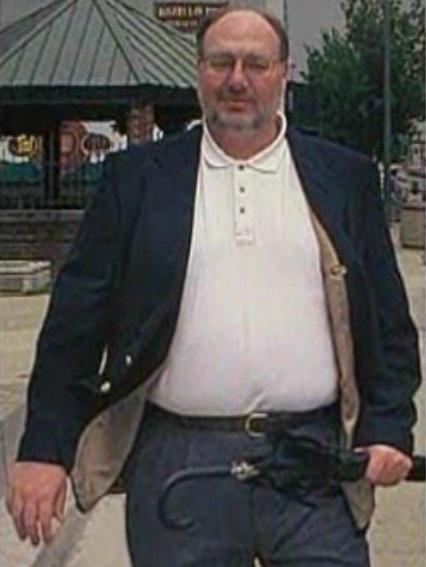 Photo of Kent Heitholt showing his normal belt buckle orientation. Columbia Tribune photo.