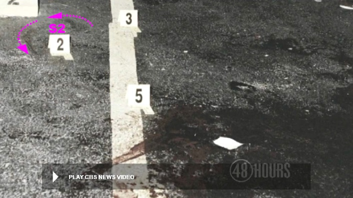 View of pavement to either side of yellow stripe. Note the possible rotational scuff markings at S2 as denoted in an earlier photo. The direction of rotation appears counterclockwise. Modified still of CBS News police video.