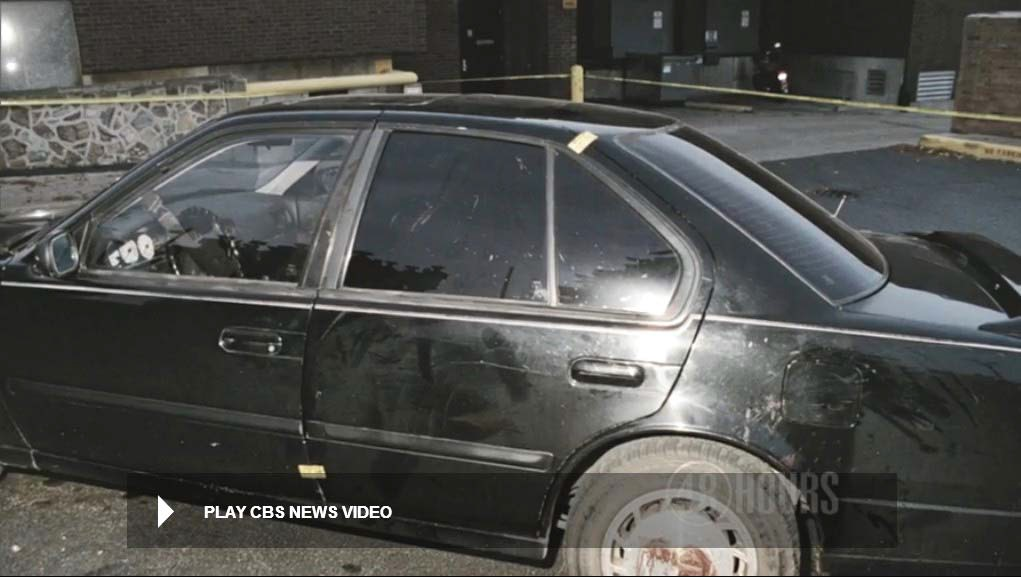 Still from police video showing driver side of Heitholt Maxima. Scrub and other contact markings can be readily seen to the left rear door window, left rear door and left quarterpanel as well as left rear wheel. Scrub markings can also be seen to outside of the left front door frame. Still from CBS News video.