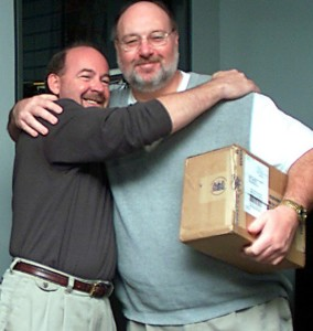 Columbia Tribune Sports Editor, Kent Heitholt, on right after being given a box of golf balls the night of October 31, 2001 by Managing Editor Jim Robertson in recognition of his five year tenure mark. This photo was taken only a few short hours before he was savagely beaten and murdered. Columbia Tribune photo.